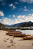 'Lake District, Cumbria, England; Rowboats On Shore'