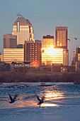 'Calgary, Alberta, Canada; Bow River And Buildings Reflecting The Sun In Winter'