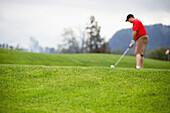 'A Man Golfing; Harrison Mills, British Columbia, Canada'
