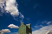 'Alberta, Canada; Clouds In The Sky Above A Grain Elevator'