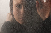 'A Woman Behind A Cold, Frosted Window; Edmonton, Alberta, Canada'
