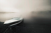 'Northwest Territories, Canada; A Boat On The Shore Of The Arctic Ocean'