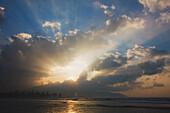 Sunburst Through The Clouds Over The Ocean