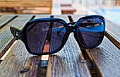 'Chiang Mai, Thailand; Sunglasses Sitting On A Table At Horizon Resort'