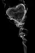 Wisps Of White Smoke In The Shape Of A Heart Against A Black Background