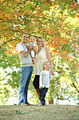 'A Family Together In A Park; Gresham, Oregon, Usa'