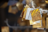 'Gold And Silver Merit Symbols Hanging In Doi Kham Buddhist Temple; Chiang Mai, Thailand'