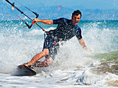 'Kite Surfing In Front Of Hotel Dos Mares; Tarifa, Cadiz, Andalusia, Spain'
