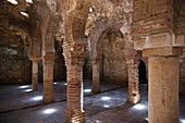 'Star Shaped Holes In The Ceiling Illuminate The Arab Bath's Arches And Supporting Columns; Ronda, Andalusia, Spain'
