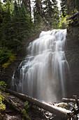 'Waterfalls Flowing Down A Rock Cliff; Waterton, Alberta, Canada'