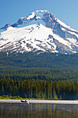 'Boating In Trillium Lake With Mount Hood In The Background In The Oregon Cascades; Oregon, United States Of America'