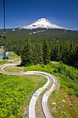 'A Chair Lift And A Track With A View Of Mount Hood In The Oregon Cascades; Oregon, United States Of America'