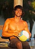 'A Man Holding A Beach Ball At Explora Beach Bar; Tarifa, Cadiz, Andalusia, Spain'