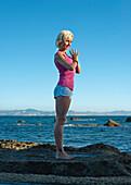 'A Woman Doing A Yoga Pose In Parque Natural Del Estrecho; Tarifa, Cadiz, Andalusia, Spain'