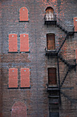 'A Fire Escape Going Up The Side Of A Brick Building; Manhattan, New York City, New York, United States Of America'