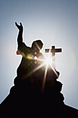 'Silhouette Of A Statue And Cross With A Sun Burst; Strasbourg, France'