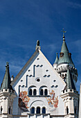 'Front Face Of A Bavarian Castle Against A Blue Sky; Fussen, Germany'