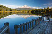 'View Of Mount Hood Reflected In Trillium Lake In Autumn From A Dock; Oregon, United States Of America'