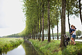 'A Couple Hugging Near A River; Houten, The Netherlands'