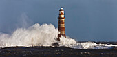 'Waves Crashing Against A Lighthouse; Sunderland, Tyne And Wear, England'