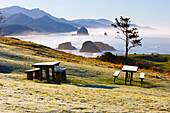 'Sunrise And Morning Fog Add Beauty To Cannon Beach And Haystack Rock From Ecola State Park; Oregon, United States Of America'