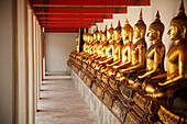 'Seated Golden Buddha Statues In A Row At Wat Pho, Temple Of The Reclining Buddha; Bangkok, Thailand'
