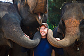 'A Man Poses With Three Elephants; Chiang Mai, Thailand'
