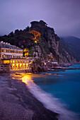 'A Building Illuminated At Night Along The Coast; Camogli, Liguria, Italy'