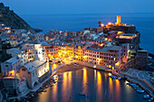 'Buildings Along The Waterfront Illuminated At Night; Vernazza, Liguria, Italy'