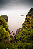 'View Of The Ocean From A Rocky Shoreline; Papey Island, Iceland'