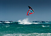 'A Windsurfer Flips Upside Down Above The Water Off Punta Paloma; Tarifa, Cadiz, Andalusia, Spain'