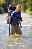 'Kananaskis, Alberta, Canada; Man Crossing A River'