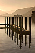 Wooden Dock In The Lake At Sunset, Cumbria, England