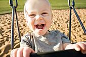 Boy In A Swing