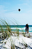 'Bradenton Beach, Florida, United States; Couple Flying A Kite On The Beach'