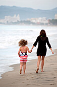 'Mother And Daughter Walking On The Beach; Puerto Vallarta, Mexico'