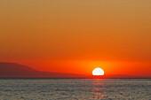 'Sunrise Over Malaga Bay; Torremolinos, Costa Del Sol, Malaga Province, Spain'