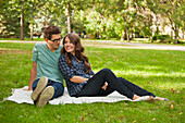 'Newlywed Couple Spending Quality Time Together In A Park; Edmonton, Alberta, Canada'