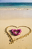 Picture Of A Heart Drawn In The Sand On A Tropical Beach, Orchid Lei Shaped Like A Heart Inside Of Drawing