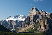 'Mountain Peaks With Cliff Face And Blue Sky; Alberta, Canada'