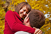 'Husband And Wife Together In A Park In Autumn; Edmonton, Alberta, Canada'