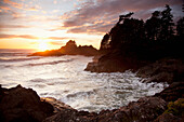 'Waves At Cox Bay And Sunset Point At Sunset Near Tofino; British Columbia, Canada'