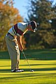 'A Man Golfing At Lynnwood Golf Course; Lynnwood, Washington, United States of America'