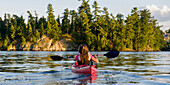 'A Girl Kayaking In The Lake; Lake Of The Woods, Ontario, Canada'