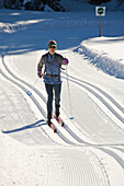 'Female Cross-Country Skier On Rolling Freshly Groomed Tracks In Kananaskis Country; Alberta, Canada'