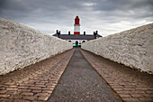 'A Path Leading To A Red And White Lighthouse; South Shields, Tyne And Wear, England'