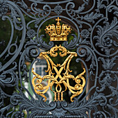 'Gold Crown And Black Metal Design On The Gate To Winter Palace; St. Petersburg, Russia'