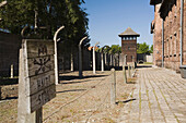 'Barb Wire Fences And Guard Tower In The Auschwitz I Former Nazi Concentration Camp; Auschwitz, Poland'
