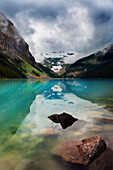 'Mountains Reflected In Tranquil Lake Louise; Alberta, Canada'