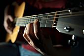 'Playing A Guitar; Edmonton, Alberta, Canada'